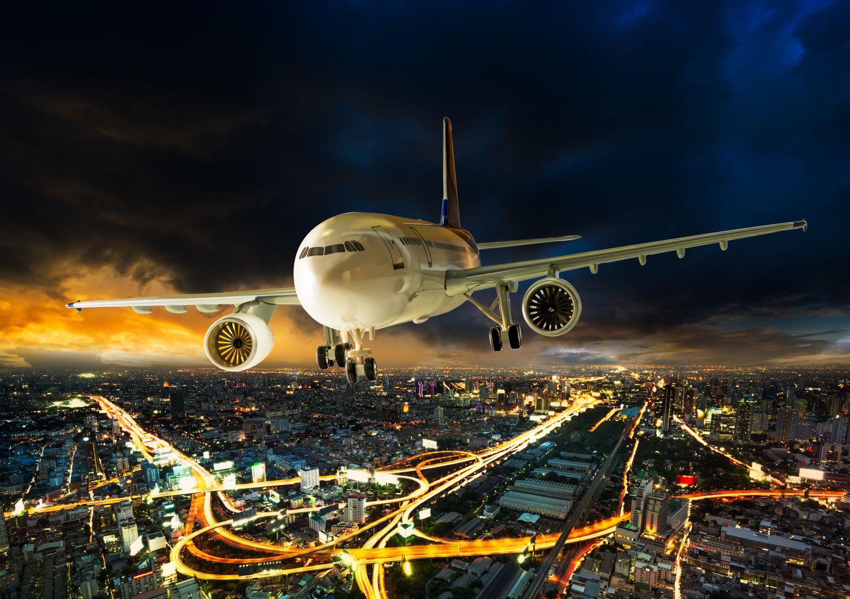 Фотообои «Самолет над ночным городом»